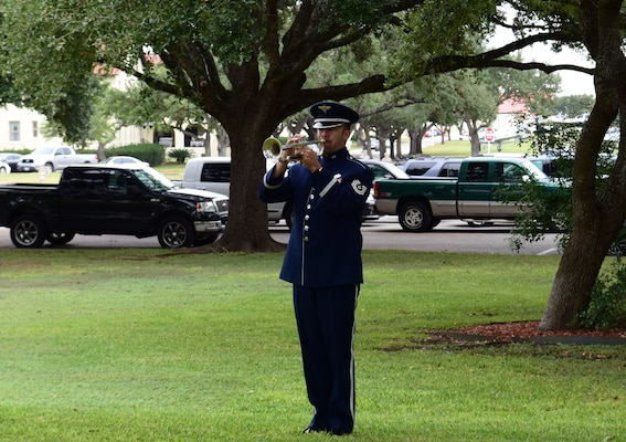Tech. Sgt. David Evans, a musician with the U.S. Air Force Band of the West plays Taps on his trumpet during a funeral for Senior Master Sgt. Karen Marshall and her husband Robert Scott Marshall Nov. 9, 2017 at Joint Base San Antonio-Randolph.  Scott and Karen were killed in a shooting at First Baptist Church in Sutherland Springs, Texas Nov. 5, 2017.  Scott was a civilian employee with the 12th Flying Training Wing and an Air Force Veteran.  Karen was an Active Guard and Reserve Airman transitioning from an assignment at Joint Base Andrews, Maryland.