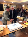 1st Lt. Steven McNamara (left) and Maj. Gen. (ret.) William Neil McCasland (ret.), cut the cake celebrating 100 years of heritage for the Air Force Research Laboratory Nov. 6 at the Heritage Annex.
