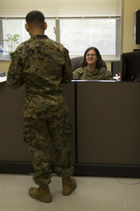 CAMP FOSTER, OKINAWA, Japan – Staff Sgt. Julianna Pinder talks to a Marine in the Headquarters and Support Battalion Family Readiness Office Nov. 6 aboard Camp Foster, Okinawa, Japan.