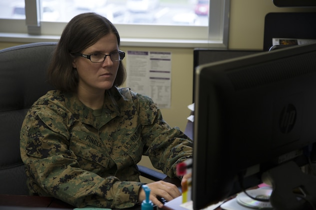 CAMP FOSTER, OKINAWA, Japan – Staff Sgt. Julianna Pinder works at her computer in the Headquarters and Support Battalion Family Readiness Office Nov. 6 aboard Camp Foster, Okinawa, Japan.