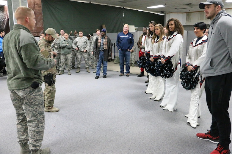 Master Sgt. Derek Geske, 21st Security Forces Squadron noncommissioned officer in-charge of training, briefs members of the Denver Broncos on training procedures Nov. 8, 2017 at the 21 SFS training facility at Peterson Air Force Base, Colorado. Current and former members of the Denver Broncos and staff toured the 21st Space Wing to learn the wing's mission, vision and goals. (U.S. Air Force photo by Staff Sgt. Erica Picariello)