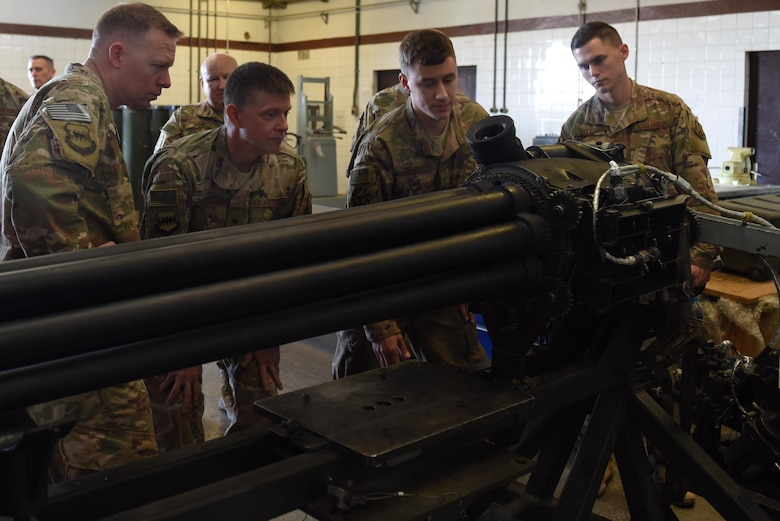 Airmen from the 447th Expeditionary Aircraft Maintenance Squadron and U.S. Air Force Brig. Gen. Kyle Robinson, 332nd Air Expeditionary Wing commander, inspect a 30 millimeter GAU-8 Avenger seven-barrel Gatling Gun undergoing repairs Nov. 7, 2017, at Incirlik Air Base, Turkey.
