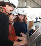Ship's Sponsors (left to right) Virginia Munford, Louisa Dixon and Pickett Wilson trace their initials onto a steel plate that will be welded inside the guided missile destroyer Lenah H. Sutcliffe Higbee (DDG 123).