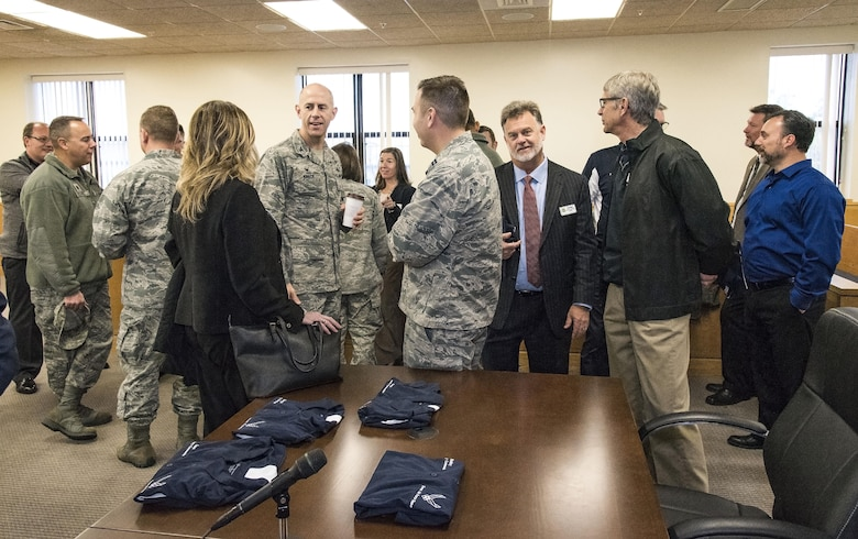 Team Dover members and honorary commanders socialize in the Legal Office court room prior to their tour of the 436th Airlift Wing Staff Agencies Nov. 8, 2017, on Dover Air Force Base, Del. The honorary commanders received mission briefings, toured various facilities and met with Team Dover WSA members during their half-day visit. (U.S. Air Force photo by Roland Balik)