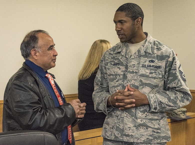 Elisio Valenzuela, 512th Maintenance Group honorary commander, speaks with Master Sgt. Harold Davis, Detachment 3, 373rd Training Squadron detachment chief, before their tour of the 436th Airlift Wing Staff Agencies Nov. 8, 2017, on Dover Air Force Base, Del. Twenty 436th and 512th AW honorary commanders toured the 436th AW staff agencies. (U.S. Air Force photo by Roland Balik)