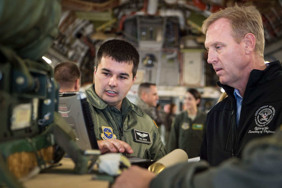 Deputy Defense Secretary Pat Shanahan speaks to a service member.