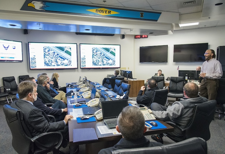 Mike Bouchard, 436th Airlift Wing Plans and Programs chief of operational plans, briefs honorary commanders on the role of crisis action team members when they convene in the installation control center Nov. 8, 2017, on Dover Air Force Base, Del. Bouchard explained to the honorary commanders regarding various situations when the CAT may be activated due to real-world or exercise occurrences. (U.S. Air Force photo by Roland Balik)