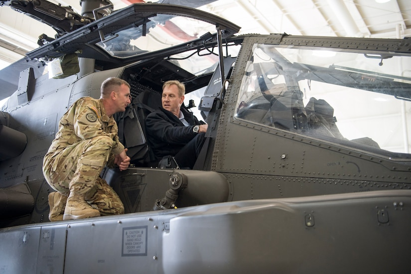 Deputy Defense Secretary Pat Shanahan sits in a helicopter.