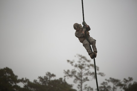 Cpl. Richard Myer, a squad leader with 2nd Battalion, 6th Marine Regiment, fast ropes out of an MV-22 Osprey during Fast Rope Masters Course 18-1 at Camp Lejeune, N.C., Nov. 9 2017.  Marines fast roped out of various helicopters day and night. The course requires Marines to be proficient at fast roping and helping other Marines fast rope out of various aircraft. (U.S. Marine Corps photo by Cpl. Victoria Ross)