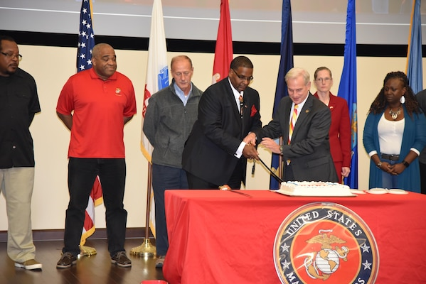 Paul Smith (left), DLA Distribution Current Operations and DLA Distribution chief of staff, Perry Knight (right) cut the cake during the 242nd Marine Corps birthday event held on Nov. 9, at DLA Distribution Headquarters in New Cumberland, Pennsylvania.