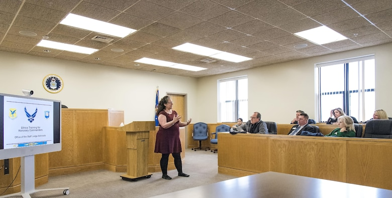 Carmel-Ann Feliciani, 436th Airlift Wing Staff Judge Advocate chief of general law, gives Team Dover honorary commanders ethics training in the SJA court room Nov. 8, 2017, on Dover Air Force Base, Del. Honorary commanders were briefed on the 14 principles of public service, setting the ethics climate, gifting rules, non-federal entities and general rules for ethical conduct. (U.S. Air Force photo by Roland Balik)
