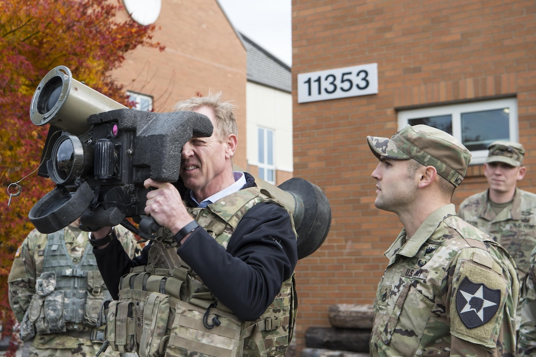 Deputy Defense Secretary Pat Shanahan holds a Javelin anti-tank weapon.