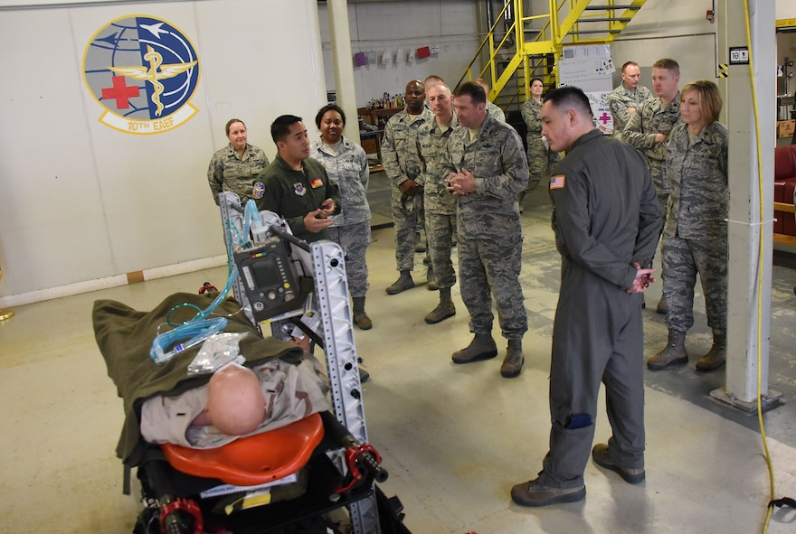 Airmen with the 313th Expeditionary Operations Support Squadron brief Maj. Gen. Christopher Bence, commander, USAF Expeditionary Center and Command Chief Master Sgt. Larry Williams, USAF EC command chief, on how they care for aeromedical evacuation patients at Ramstein Air Base, Germany, Nov. 2, 2017. Bence and Williams along with the 521st Air Mobility Operations Wing leadership team visited six squadrons of the 521st AMOW at Ramstein AB and Spangdahlem AB, Germany, Aviano AB, Italy and RAF Mildenhall, U.K. (U.S. Air Force photo by Tech. Sgt. Jamie Powell)