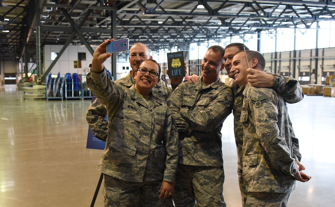 Maj. Gen. Christopher Bence, commander, USAF Expeditionary Center and Command Chief Master Sgt. Larry Williams, USAF EC command chief, pause to take a 'selfie' while visiting Airmen assigned to the 721st Aerial Port Squadron at Ramstein Air Base, Germany, Nov. 4, 2017. Bence and Williams along with the 521st Air Mobility Operations Wing leadership team visited six squadrons of the 521st AMOW at Ramstein AB and Spangdahlem AB, Germany, Aviano AB, Italy and RAF Mildenhall, U.K. (U.S. Air Force photo by Tech. Sgt. Jamie Powell)