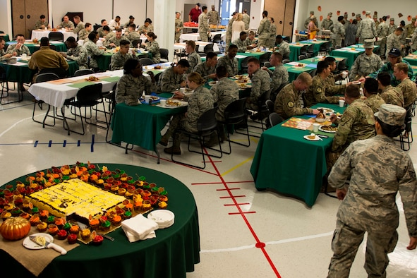 Airmen and their families eat during the Annual Airmen's Thanksgiving luncheon, Nov. 14, 2017, at Moody Air Force Base, Ga. Moody Chiefs Group, with the support of various base organizations, held the luncheon because many Airmen are unable to return home for Thanksgiving. (U.S. Air Force photo by Airman 1st Class Erick Requadt)