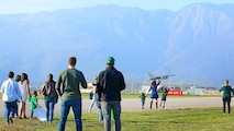 Team Aviano members watch F-16 Fighting Falcon pilots from the 555th Fighter Squadron land at Aviano Air Base, Italy, Nov. 1, 2017.  Approximately 380 Airmen and 18 F-16s were deployed to Bagram Air Field, Afghanistan to support Operation Freedom's Sentinel. (U.S. Air Force photo by Airman 1st Class Ryan Brooks)