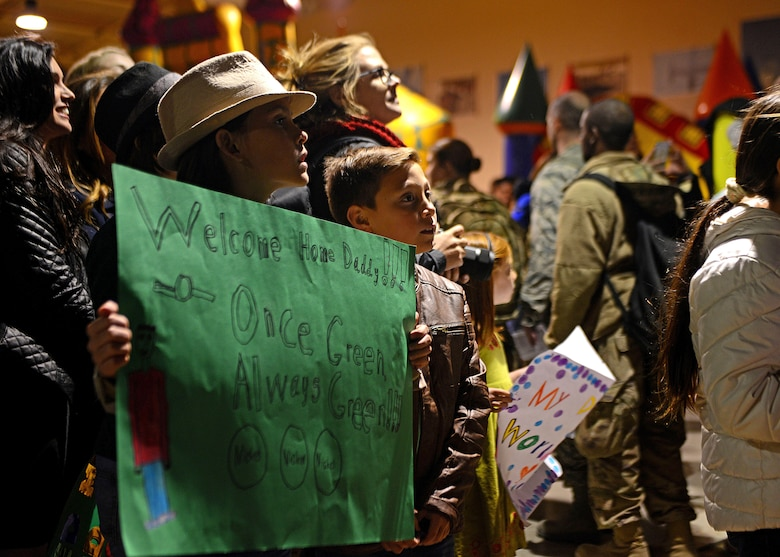 Children wait to welcome home their father at Aviano Air Base, Italy, Nov. 6, 2017. Their father was one of 380 Airmen to deploy to Bagram Air Field, Afghanistan in support of Operation Freedom's Sentinel.  (U.S. Air Force photo by Airman 1st Class Ryan Brooks)