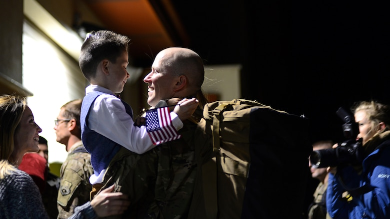 An Airman greets his son at Aviano Air Base, Italy, Nov. 6, 2017. The Airman was one of 380 Airmen and who were deployed to Bagram Air Field, Afghanistan to support of Operation Freedom's Sentinel. (U.S. Air Force photo by Airman 1st Class Ryan Brooks)