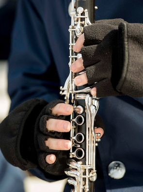 Close up of band member playing the clarinet