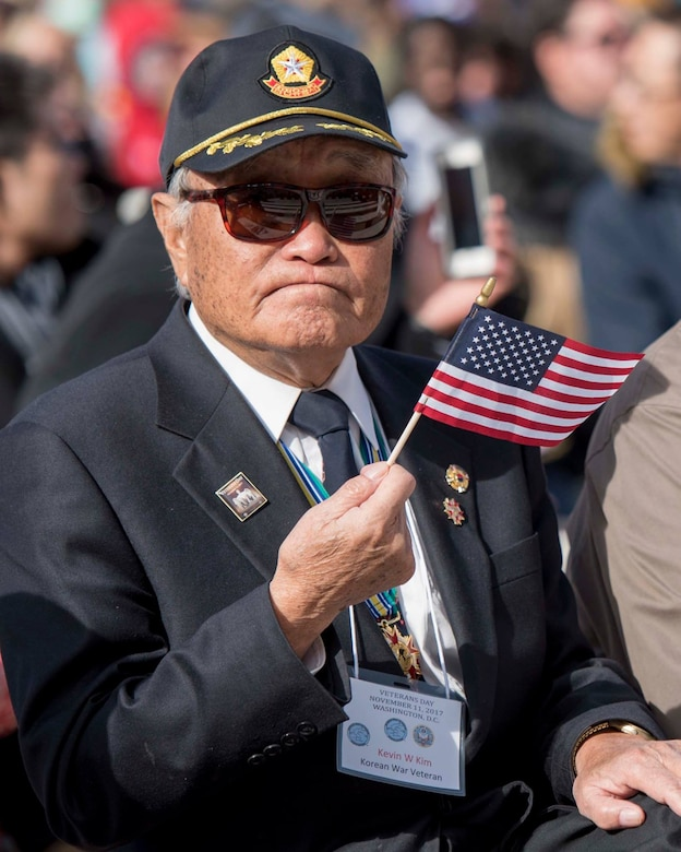 Korean War veteran waves American Flag