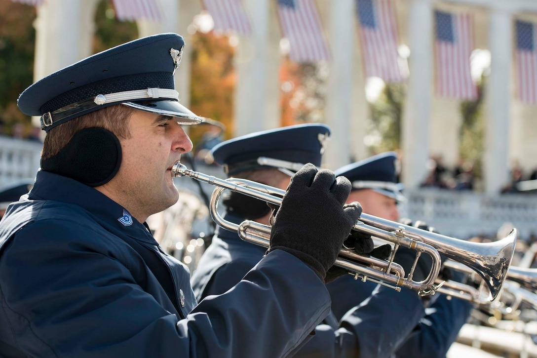 Air Force band members play the trumpet
