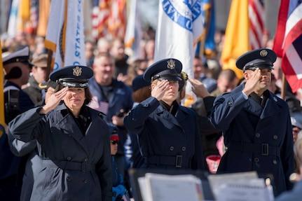Air Force members salute the American Flag