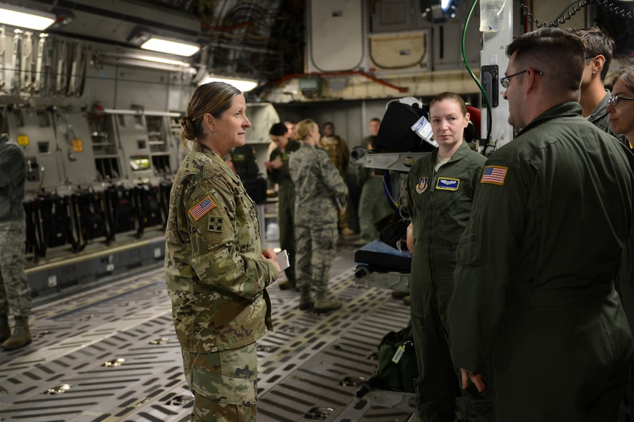 Airmen from the 446th Aeromedical Evacuation Squadron brief Army Col. Nicole Lucas, Joint Base Lewis-McChord garrison commander, on their mission, Nov. 6, 2017, in a C-17 on the McChord Field flightline.