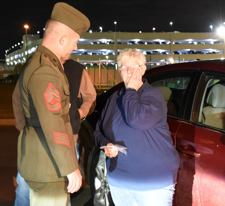 Sandra Lewis, the niece of Marine Corps Pvt. Vernon Paul Keaton wipes tears away after speaking with Gunnery Sgt. Nicholas Brundige, Assistant Marine Corps funeral director, Marine Headquarters Barracks, Washington, D.C., speaks with , in a secluded section of Will Rogers World Airport November 14, 2017, Oklahoma City, Oklahoma.