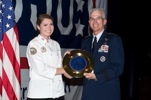 Air Force Gen. Paul J. Selva presents an award