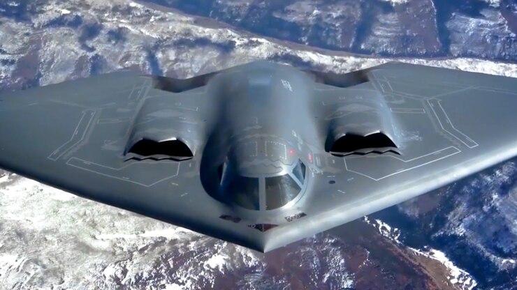 An aircraft flies over the ground.
