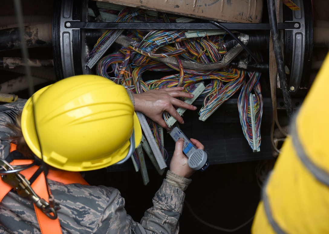 211th EIS Airmen install fiber optic cables