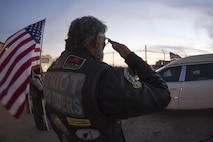 A member of the Oklahoma Patriot Guard Riders salutes the hearst as it drives past to retrieve the remains of Marine Corps Pvt. Vernon Paul Keaton November 14, 2017, Will Rogers World Airport, Oklahoma City, Oklahoma.