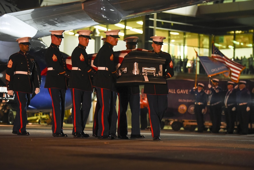 A Marine Corps carry team transfers the remains of Marine Pvt. Vernon Paul Keaton November 14, 2017, Will Rogers World Airport, Oklahoma City, Oklahoma. Keaton was killed Dec. 7, 1941, during the Japanese attack on Pearl Harbor, Hawaii.
