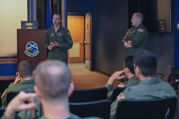 Capt. Joe Zujus, 48th Flying Training Squadron flight commander, speaks to 14th Airlift Squadron pilots about the expectations, background and benefits to becoming a T-1A Jayhawk or T-6A Texan II jet trainer aircraft instructor at the 14th AS on Joint Base Charleston, S.C., Nov. 13, 2017.