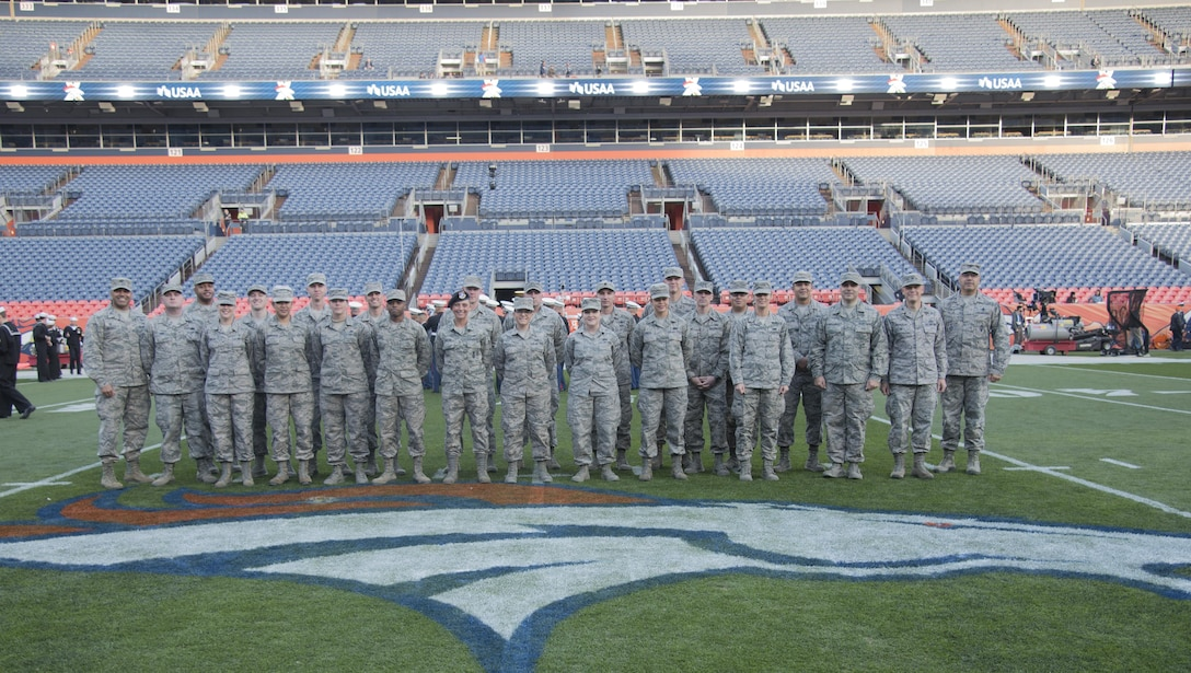 Team Buckley members gather for a group photo on the 50-yard line prior to rehearsing their pre-game ceremony roles Nov. 12, 2017, at Sports Authority Stadium at Mile High in Denver.