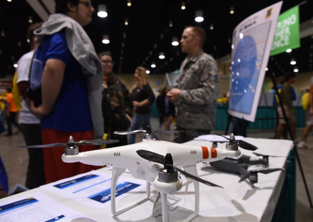Staff Sgt. Travis Schupp, 81st Operations Support Flight tower watch supervisor, (right), explains the guidelines for flying drones near Keesler Air Force Base during the Pathways2Possibilities (P2P) event at the Mississippi Coast Coliseum & Convention Center Nov. 15, 2017, in Biloxi, Mississippi. P2P is a hands-on interactive career expo for all 8th graders and at-risk youth, ages 16-24 in South Mississippi. (U.S. Air Force photo by Kemberly Groue)