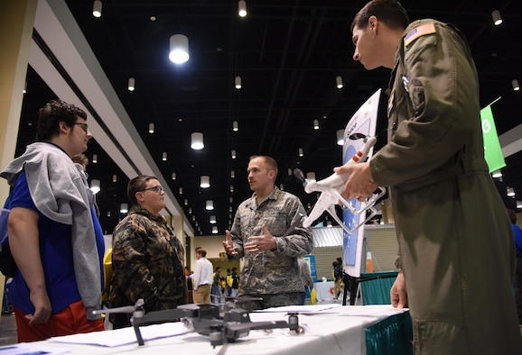 Staff Sgt. Travis Schupp, 81st Operations Support Flight tower watch supervisor,  and Maj. Dave Gentile, 53rd Weather Reconnaissance Squadron pilot, explains the guidelines for flying drones near Keesler Air Force Base during the Pathways2Possibilities (P2P) event at the Mississippi Coast Coliseum & Convention Center Nov. 15, 2017, in Biloxi, Mississippi. P2P is a hands-on interactive career expo for all 8th graders and at-risk youth, ages 16-24 in South Mississippi. (U.S. Air Force photo by Kemberly Groue)