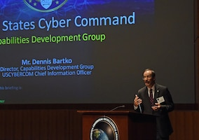 Dennis Bartko, the director of U.S. Cyber Command's Capabilities Development Group, addresses attendees at the command's first-ever industry day held at the National Geospatial-Intelligence Agency's Arthur Lundahl Conference Center at Fort Belvoir, Va., Oct. 27, 2017. Leaders from across Cybercom briefed nearly 400 members of private industry about the command's acquisition priorities. Courtesy photo