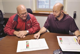 Alan Ingwersen, left, assistant master planner at Directorate of Public Works Master Planning Division, and BJ Watson, DPW planning division chief, analyze the fiscal year 2017 submission list for Military Construction projects at Public Works office Oct. 4. Each year, master planners of Fort Riley make a good case for the installation to receive funding and appropriations from congress to build new facilities.