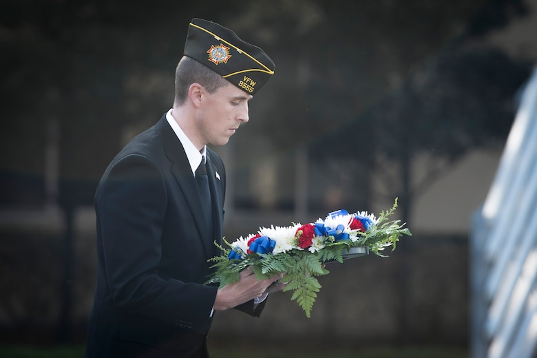 A veteran carries a memorial wreath during a Veterans Day Ceremony, Nov. 10, 2017, at Yokota Air Base, Japan.