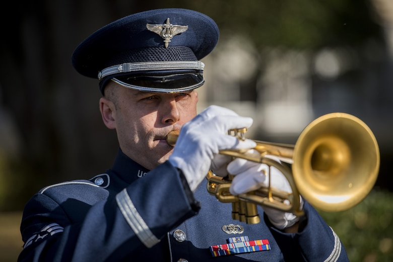 A member of the U.S. Pacific Air Forces band plays Taps during a Veterans Day Ceremony, Nov. 10, 2017, at Yokota Air Base, Japan.