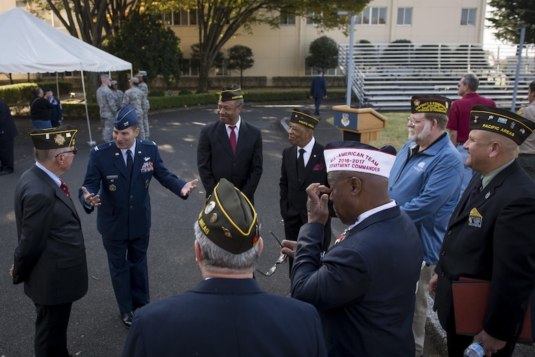 Col. Sergio Vega, 374th Airlift Wing vice commander, speaks with members of the Veterans of Foreign Wars Post 9555 during a Veterans Day Ceremony, Nov. 10, 2017, at Yokota Air Base, Japan.