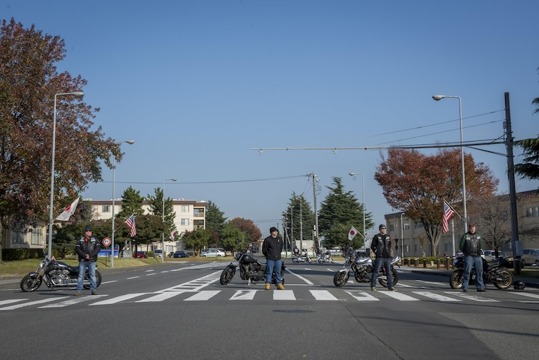 The Green Knights motorcycle club blocks traffic during a Veterans Day Ceremony, Nov. 10, 2017, at Yokota Air Base, Japan.