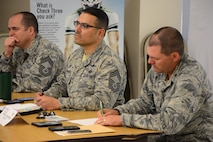 U.S. Air Force Chief Master Sgt. Thomas Merrill, 392nd Intelligence Squadron superintendent, U.S. Air Force Chief Master Sgt. Gillie Zamora, 690th Cyberspace Operations Squadron superintendent, and U.S. Air Force Maj. Kurt Weissgerber, 690th Cyberspace Operations Squadron commander, all at Joint Base Pearl Harbor-Hickam, Hawaii, participate during a Continuous Process Improvement Senior Leaders Course held at JBPHH Nov. 6, 2017.