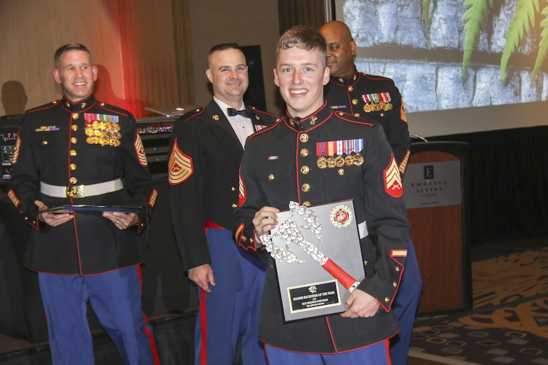 Sgt. Shawn Stevens, recruiter, Recruiting Substation South Omaha, Neb., receives a plaque for winning Marine Corps Recruiting Station Des Moines' Rookie Recruiter of the Year at Embassy Suites in Des Moines, Iowa, Nov. 11, during the 242nd Marine Corps Birthday Ball. (Official Marine Corps photo by Sgt. Levi Schultz)