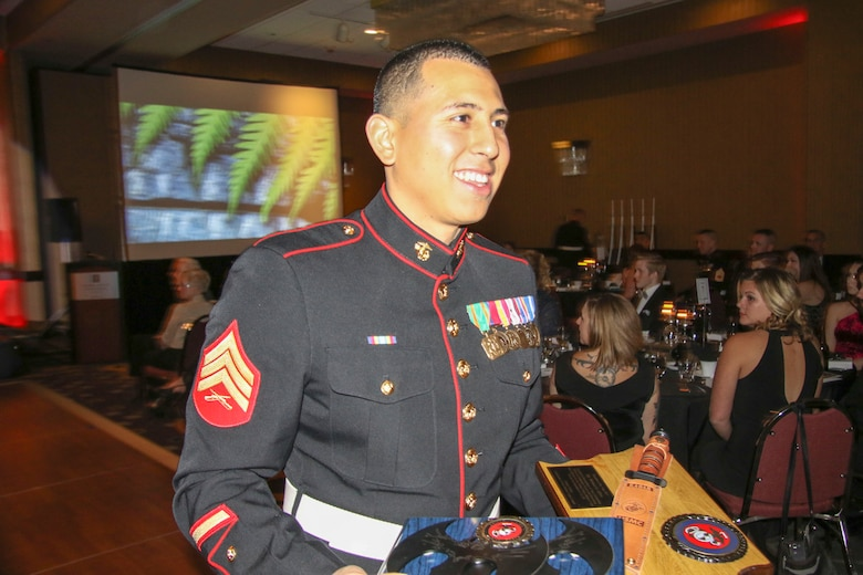 Sgt. Michael Alfaro, recruiter, Recruiting Substation West Omaha, Neb., receives a plaque for winning Marine Corps Recruiting Station Des Moines and 9th Marine Corps District's Recruiter of the Year at Embassy Suites in Des Moines, Iowa, Nov. 11, during the 242nd Marine Corps Birthday Ball. (Official Marine Corps photo by Sgt. Levi Schultz)