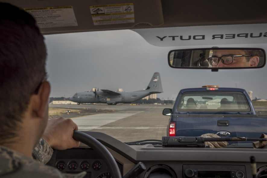 Senior Airman Brendan Kinser, 374th Civil Engineer Squadron pavements and equipment journeyman, waits for a C-130J Super Hercules to take off prior to driving on the flight line, Nov. 15, 2017, at Yokota Air Base, Japan.