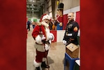 Kelty participates in a Toys for Tots event.