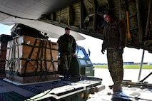 Senior Airman Jordon Speedy, 41st Airlift Squadron loadmaster, and Royal Canadian Air Force  Sergeant Perter Larue, 2 Air Movement Squadron NCO in Charge of tactical operations, load  Container Delivery System bundles on a Little Rock AFB C-130J at Canadian Forces base Trenton in Ontario, Canada, Nov. 6, 2017. The size and weight of the CDS's vary to simulate different loads the aircraft might carry. (U.S. Air Force photo by SSgt Jeremy McGuffin)