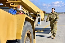 Airman 1st Class Brittany Deberry, 41st Airlift Squadron loadmaster, guides a Canadian crane truck onto a Little Rock Air Force base C-130J at Canadian Forces base Trenton in Ontario, Canada, Nov. 7, 2017.  The unique size and shape of the crane provided training for the loadmasters they normally don't encounter at Little Rock AFB. (U.S. Air Force photo by SSgt Jeremy McGuffin)